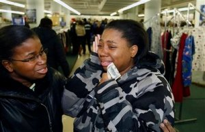 Lakresha Moore is overcome by emotion after being handed a $100 bill by a Secret Santa